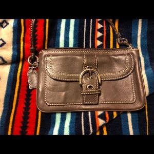 Coach leather wristlet with buckle clasp